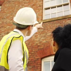 bigstock-Surveyor-Or-Builder-And-Homeow-36611071