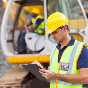 bigstock-construction-manager-writing-r-46349137